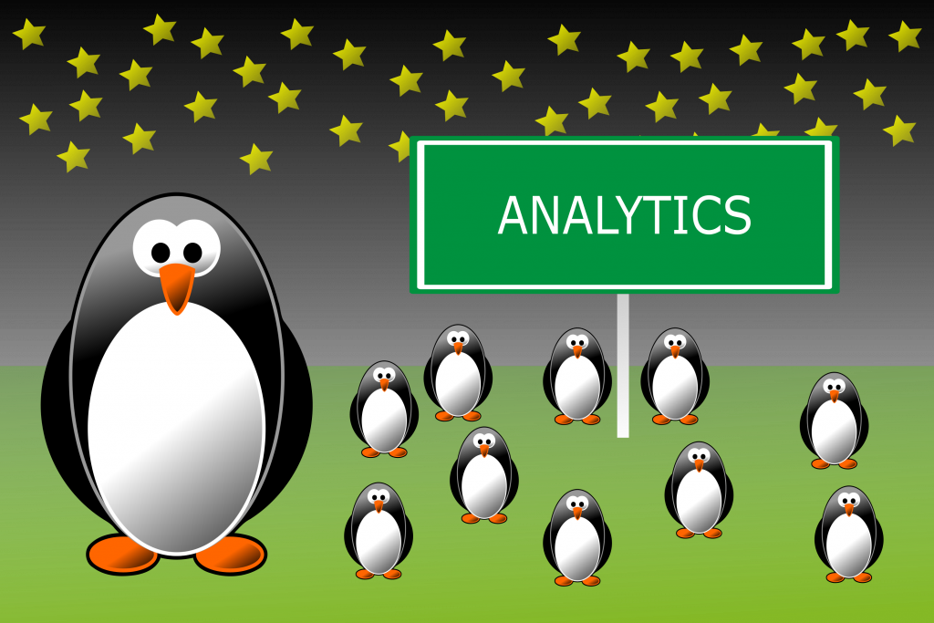 An illustration of penguins standing around a sign that reads Analytics.